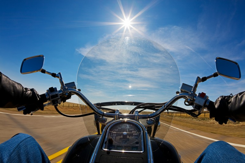 Biker enjoying a ride in the country side on a sunny day; Shutterstock ID 22235944